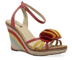 Fun, floral and classy. Make a chic vacation choice with these multi hued strappy wedge sandals .