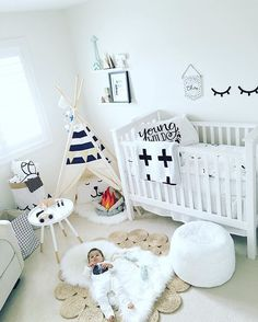 A modern black and white nursery featuring /modernburlap/ blankets and incorporating Scandinavian design elements to create the perfect gender neutral nursery. The white crib and jute rug go with every accessory throughout the seasons.