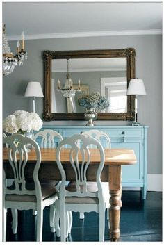 turquoise blue farmhouse dining room design with farmhouse wood dining table with French painted chairs is just terrific! The rustic antique painted blue buffet table goes so well with the ornate wood turquoise blue gray dining room Home Interior, Interior Design, Interior Decorating, Eclectic Design, Eclectic Decor, Modern Interior, Dining Room Paint Colors, Wall Colors, Bedroom Colors