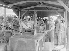 THE BRITISH ARMY ON THE ITALIAN FRONT, 1917-1918 Troops of the Royal Army Service Corps and Italian workers sawing wood for fires at the Army bakery.