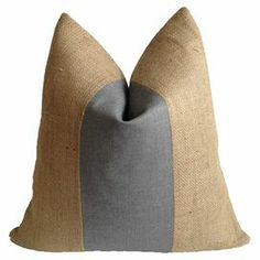 "Eco-friendly and made in the USA, this chic burlap pillow features grey linen-cotton striping and a plush feather-down fill.  Product: PillowConstruction Material: Burlap, linen-cotton blend cover and 95/5 feather-down fillColor: Gray and naturalFeatures:  Made in the USAEco-friendly constructionInsert included Dimensions: 20"" x 20""Cleaning and Care: Spot clean"