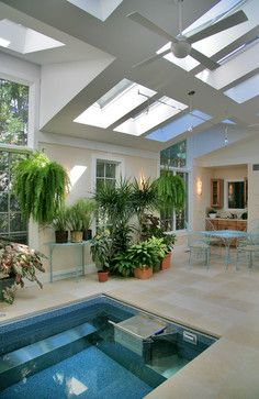 Sunroom/greenhouse with endless pool, breakfast area and bar