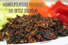 Hamburguesas veganas de arroz salvajeIngredientes:  – 100 gr de arroz salvaje  – 1 zanahoria  – 1 cebolla  – 3 tomates secos  – 2 dientes de ajo  – 1 cucharadita de pimentón dulce  – 1 puñado de nueces  – 1 cucharada de harina de garbanzo  – Perejil