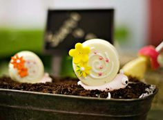 """chocolate covered Oreo """"snails"""" on a bed of cookie crumb dirt - so cute!! {Girly Garden Birthday Party}"""