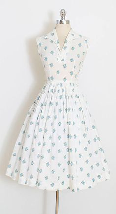 ➳ vintage 1950s dress * darling white swiss dot cotton * blue rose print * open neckline * metal side zipper condition | excellent fits like xs length 43 bodice 16 bust 34-36 waist 24-25 ➳ shop http://www.etsy.com/shop/millstreetvintage?ref=si_shop ➳ shop policies http://www.etsy.com/shop/millstreetvintage/policy twitter | MillStVintage facebook | millstreetvintage instagram | millstreetvintage 5945/1716