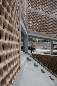 Hospital for a rural Chinese community features a ramp that slopes up to the roof