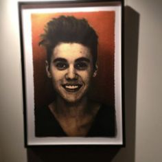 Justin Bieber mugshot exhibit at Sherman Oaks Arclight, 2014.