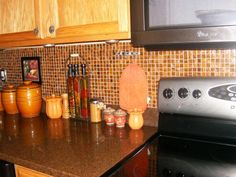 A nice dark brown granite goes with the orangie backsplash.