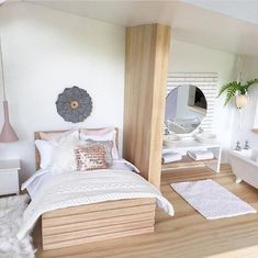 Overall the visual weight is balanced because the heavy bed frame on the left side is balanced by the light weight suspended plant in the bathroom on the right. In addition the abundance of white walls and white fixtures also balance out the heaviness of the bed. Unity has been created by the use a circular wall art in the bedroom and a circle mirror in the bathroom.
