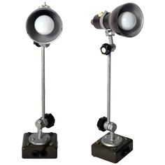 This pair of industrial lamps are from France c. 1940 and are made from metal