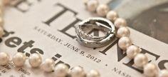 Wedding bands and pearls ring shot