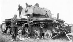 German soldiers examining hit KV-1 tank (with extra armor}. Krasnogvardeisk region, 1941. The tank got under heavy artillery fire - It has many signs of shell hits, the gun was blown from the recoil system. The KV-1 - was a Soviet tier 5 heavy tank.