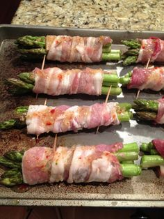 Bacon-wrapped Asparagus. Toss fresh asparagus in 1 cup of zesty Italian dressing, 1 tbsp of minced garlic, a dash of lemon juice, and salt & pepper until coated well. Wrap 5 pieces of asparagus tightly in 1 piece of bacon and secure it at both ends with tooth picks. Drizzle the remaining zesty Italian mixture on the wrapped asparagus for extra flavor. Grill or bake at 400 degrees for 30-40 minutes or until the bacon is crispy and the asparagus is tender. Turn every 10 minutes. YUM!
