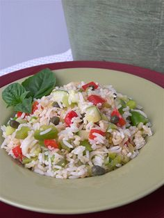 Italian Cold Rice Salad ~ Insalata Riso ~ This is what my relatives in Italy eat all summer--perfect for picnics at the beach. Be inventive with your ingredients (just like pasta), but be sure to include capers and frozen peas. Sometimes they add tuna and that's good too. Simple olive oil and vinegar dressing.
