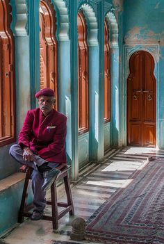 INDIA:  artistic reflection in aqua arched window room
