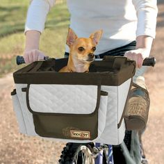 Snoozer Pet Bicycle Basket-Bring your dog with you on a leisurely bike ride. This patented bike basket by Snoozers provides a safe and comfortable place for your dog to enjoy the company of their person while biking. A mesh water bottle pocket gives Pet Dogs, Dog Cat, Pets, Doggies, Pet Bike Basket, Bike Baskets, Cat Basket, Dog Bike Carrier, Biking With Dog