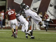 Missouri's Kony Ealy, right, (47) leaps to tackle Indiana's Ted Bolser (83) following a reception during the first half of an NCAA college f...  #IUCollegeFootball