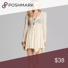 Free People Intimates ivory sheer lace dress Small Free People Star Lace Witchy Slip Dress   Color: Ivory   Size: S  Bust: 16'' arm pit to arm pit            Made from sheer, feminine lace, the Free People Witchy Long Sleeve Slip Dress features a v-neckline and casts a charming, a-line silhouette with long sleeves, pleated skirt, and an asymmetric high and low hem.  Pullover style.   Nylon/spandex.  Machine wash. Free People Dresses Asymmetrical