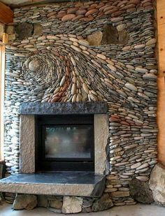 River rock fireplace. If I could have an artistic design similar to this in my future home but with the functionality of a wood stove, I would be delighted.