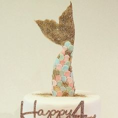 Fabulous and glam mermaid tail topper in fondant/gum paste for your mermaid party theme cake!!!!  This listing is for 1 gold mermaid tail cake topper with gold fins and gold, light blue, light pink coloured tail scales OR you can request all one colour. The fin will have some gold glitter sprinkled over it! YEY!  NOTE: Approx: 6-7L x 4W  Please take note that the back of the topper is white.  Please allow sufficient time to order before your need/party date so I can make sure that it is…