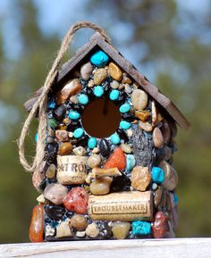 Outdoor hanging stone birdhouse with wine corks, turquoise and other colorful gemstones