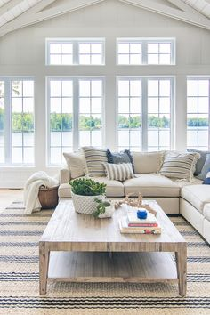 Lake House Blue and White Living Room Decor. Large windows, paneled walls and ce.Lake House Blue and White Living Room Decor. Large windows, paneled walls and ceiling beams with blue and white decor and warm wood tones. Cottage Living Rooms, Coastal Living Rooms, Home Living Room, Apartment Living, Coastal Decor Living Room, Coastal Cottage, Lake House Family Room, Cozy Cottage, Coastal Style
