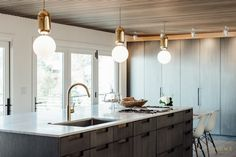 cityhomeDESIGN - kitchen remodel with granite countertops, brass pendants, and custom cabinetry
