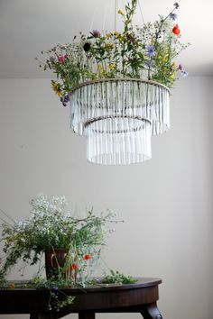 Hanging flowers in the chandelier.  I know what would happen to me, I'd leave them till they were dead and hanging down.  Great for big events and love the idea.