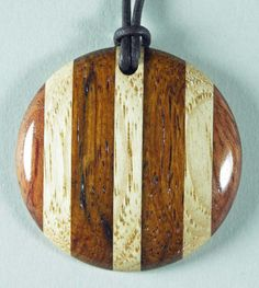 Wood Pendant Woodturning made of Hickory, Bubinga & Rosewood. $25.00, via Etsy.