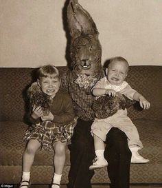 Creepy Easter Bunnies- Double trouble:In one old-fashioned black and white photo, a brown Easter bunny sits in between two children's distraught faces