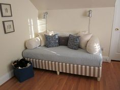 Faux daybed: boxsprings covered in fabric, painted furniture feet directly attached, mattress covered up & pillows to accessorize
