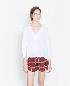 http://www.zara.com/us/en/woman/shirts-c269186.html#product=1295131&viewMode=two