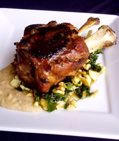 Braised pork shank with crispy spaetzle, cannellini bean puree, fried watercress and pan jus. MMM! Just saying that makes our mouth water. Available at Lombard.