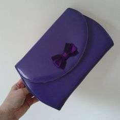 Purple 1980s vintage clutch bag with decorative bow detail and detachable shoulder strap by DottysVintageFinds on Etsy