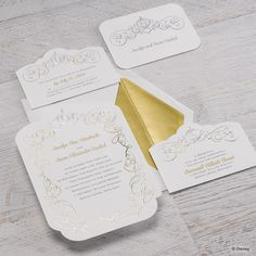 A modern illustration of Cinderella's classic carriage tops this uniquely beautiful wedding invitation perfectly while whimsical swirls in shimmering silver and gold create a magical frame around your wording.