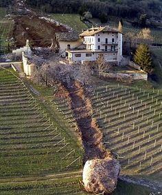 Dramatic pictures have been released showing the destruction wrought by a huge boulder that smashed through a farm in Northern Italy after being dislodged by a landslide.