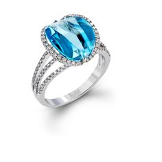 ZR1281- This unique 14k white gold ring contains a 5.58 ct blue topaz.