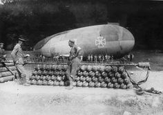 WWI: German soldiers attend to a stack of gas canisters attached to a manifold, inflating a captive balloon on the Western front. (National Archives/Official German Photograph)