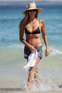Beach babe: Elle Macpherson showed off her hard-earned body while on the beach in Australia on Sunday afternoon Elle Macpherson, Famous Supermodels, Priscilla Barnes, Sport Bikinis, Dark Blonde Hair, Celebrity Bikini, Ladies Gents, Black Bikini Tops, Beach Babe