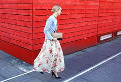 Feminine florals in a full volume skirt and a graphic sweatshirt.