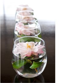 Use stemless wine glasses to float candles down your table or around the site on cocktail tables or other accent pieces