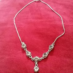 """Vintage Sterling silver & smoky quartz necklace. Vintage sterling silver & smoky quartz necklace. about 16"""" in length. Adorned with six faceted smoky quartz stones. Orignial patina. Picked up from a vintage boutique about 10 years ago and I maybe wore it once. (I have too much jewelry. HELP) Vintage Jewelry Necklaces"""
