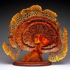 """Blooming"" (Front). 24""h x 24""w x 6""d. Amboyna Burl with Bubinga base. George Post, photography."