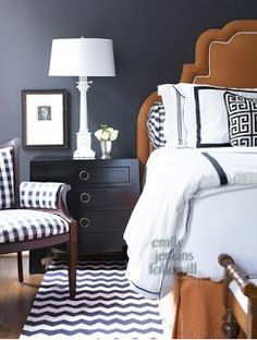 Black & White & Grey & Gingerbread:  This is an interesting, unexpected mix of graphic black and white patterns. The white accessories and grey wall help bring the gingerbread colored bed intro the palette.