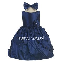 Baby Dress with Heavenly Skirt: It's been awhile since we have seen such a unique dress! This navy blue baby dress features a beautiful celestial skirt with petite round cut outs and diagonal pin tucks swirling around and around. This sleeveless dress is further accented with a detachable rhinestone flower accent at the pleated waistline and has additional netting underneath for a fuller look. This navy baby dress will make one baby girl very happy on multiple occasions as it is very versati...