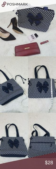 Blue and White Polka Dot Shoulder Bag Excellent condition. Never used. | Blue and White polka dot. Bow on front. | Draw strings on sides to tighten bag. | All zippers work. Three pockets inside. Zipper pocket on outside. | Bought from Thailand. Great quality. | Could be used as a lunch bag, small diaper bag, purse, etc. Bags Shoulder Bags