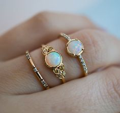 Floral Edwardian Engagement Ring Motif with Australian Opal and Yellow Diamonds Inspired by Edwardian antique engagement ring designs, this finely