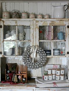 great old cabinet- wonder if I can use old windows and make one?