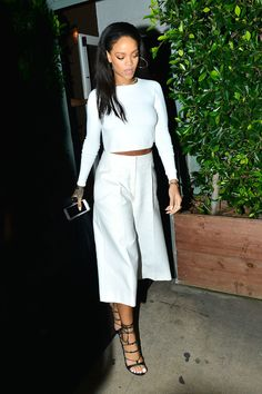 Who: Rihanna What: The Cropped Pant Why: Leave it to the style-setter to expertly embrace the new pant shape in a clean monochromatic look. Get the look now: Apiece Apart pants, $390, apieceapart.com. - HarpersBAZAAR.com