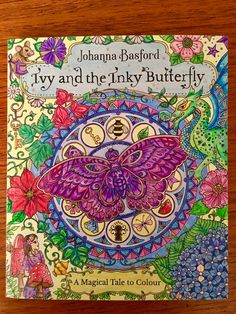 My colouring of front cover of Johana Basford's Ivy and the Inky Butterfly. Used Ergosoft, Prismacolour,gel pens(sparkle) and Cosmic Shimmer paint. The sparkle effect doesn't show in this photo!